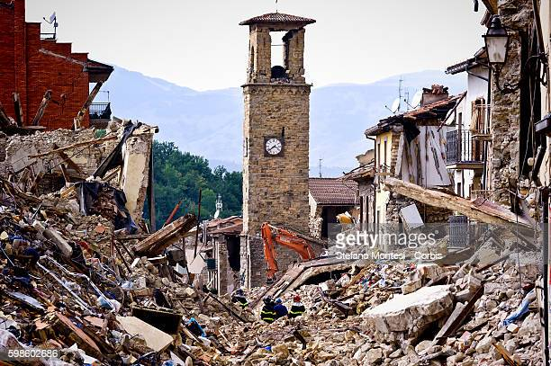 Firefighters continue removing rubble near the bell tower in Amatrice central Italy on August 30 2016 Italy Italy was struck by a powerful...