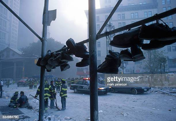 Firefighters continue search and rescue efforts following the attack on the World Trade Center Photo by Mark Peterson/Corbis Saba