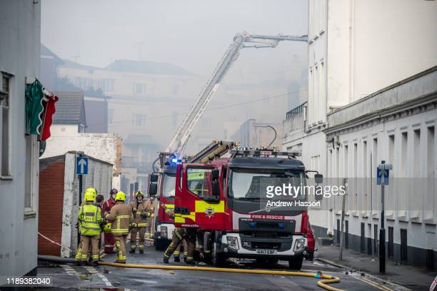 Firefighters continue to fight the blaze in Burlington Road directly behind the iconic Claremont Hotel on November 22 2019 in Eastbourne England...