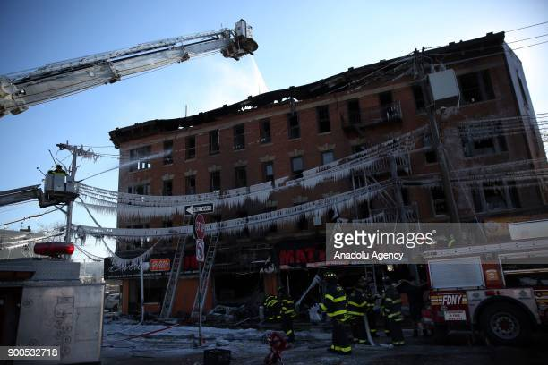 Firefighters continue works to extinguish a fire that broke out at an apartment leaving 16 injured according to initial reports at the Commonwealth...