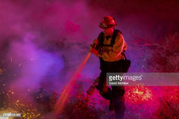 Firefighters control a backfire they set at the Maria Fire which exploded to 8000 acres on its first night on November 1 2019 near Somis California...