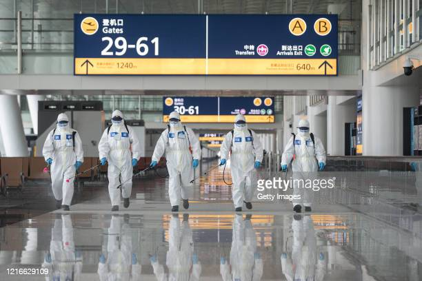 Firefighters disinfect the Wuhan Tianhe International Airport on April 3, 2020 in Wuhan, Hubei Province, China. Wuhan, the Chinese city hardest hit...