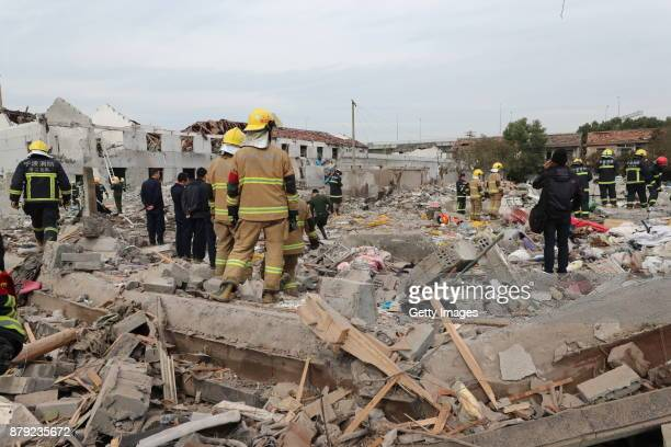 Firefighters do rescue works at the site after a blast in Jiangbei District on November 26 2017 in Ningbo Zhejiang Province of China The explosion...