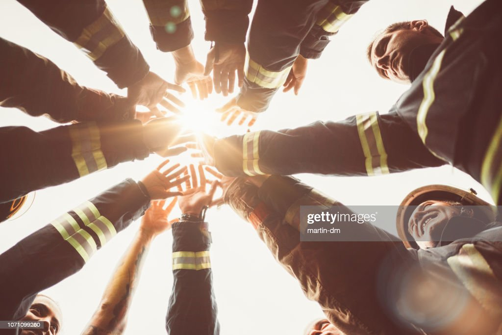 Firefighters doing high five : Stock Photo