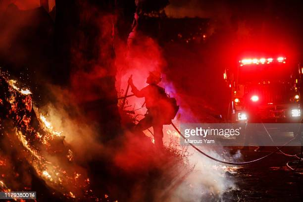 PAULA CALIF FRIDAY NOVEMBER 1 2019 Firefighters douses flames from a back fire as they battle the spread of the Maria Fire moving quickly towards...