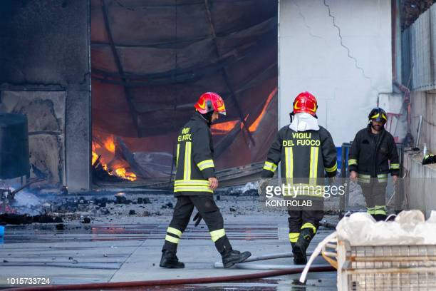 Firefighters during the phases of extinguishing a large fire that destroyed a shed with Cash and Carry activities in the industrial area of...