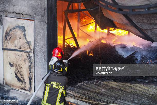 IRENE ROSSANO CALABRIA ITALY Firefighters during the phases of extinguishing a large fire that destroyed a shed with Cash and Carry activities in the...