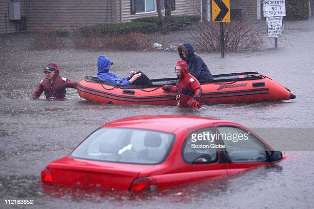 Firefighters evacuated Joe and Joyce Butler from their home on Fordson Avenue in Cranston RI as heavy rains swelled the Pawtuxet River