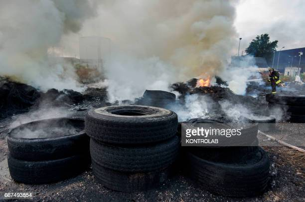 Firefighters extinguish a huge fire of toxic waste in the city center of Naples The fire began in the early hours of the morning in Naples