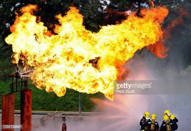 Fire-fighters extinguish a simulated gas leak during one of the largest ever exercises organised by the UK Fire and Rescue Services, in Liverpool,...