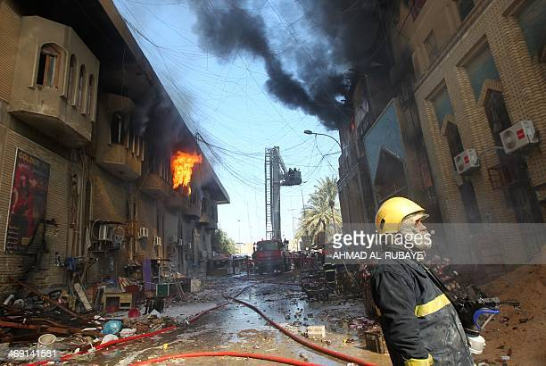 Firefighters extinguish fire from Baghdad's historic Shorjah market which dates to the Abbassid era over 700 years ago after it was hit by two bomb...