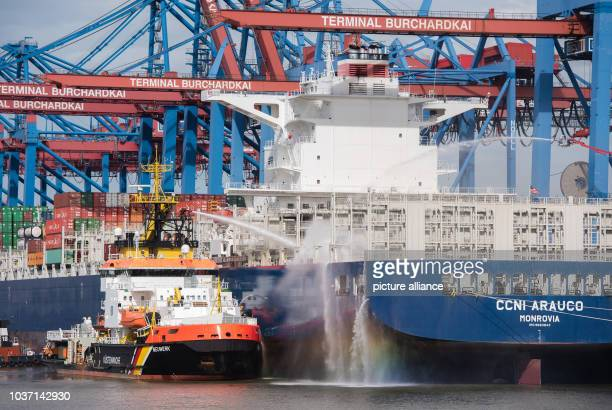 Firefighters extinguishing a fire on the containership 'CCNI Arauco' in Hamburg Germany 2 September 2016 The extinguishing works at the Burchardkai...