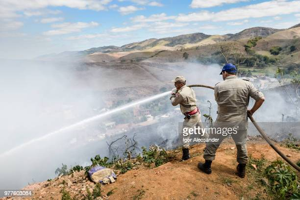 firefighters extinguishing burnt on top of a hill, rio de janeiro, brazil - slash and burn stock pictures, royalty-free photos & images