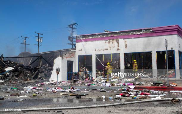 Firefighters from Culver City and Los Angeles finish up battling a blaze in a 99 Cent store in Culver City at 1217 Washington Blvd It was reported...