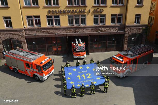 Firefighters from Firehouse 1 in Stuttgart hold a flag written with 'emergency number 112 Europewide' in Stuttgart Germany 19 July 2016 On 29 July...