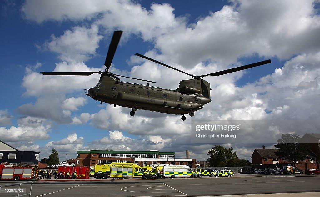 Firefighters from Merseyside Fire Brigade look on as an RAF Chinook helicopter lands rescue crews during the UK's biggest ever rescue exercise on September 7, 2010 in Liverpool, England. The National Urban Search & Rescue Exercise simulated an earthquake and involved brigades across the UK. Part of the simulation included vehicles and people trapped in the Mersey Tunnel.