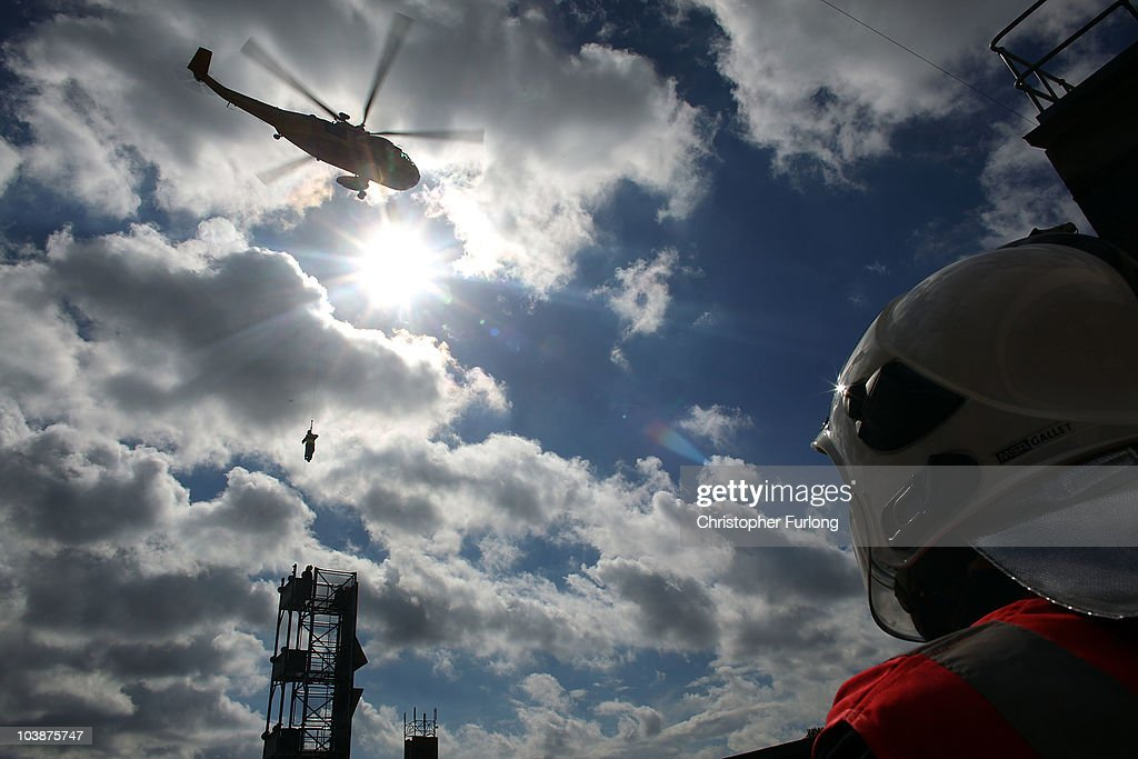 Firefighters from Merseyside Fire Brigade look on as an RAF rescue helicopter lifts a simulated casualty during the UK's biggest ever rescue exercise on September 7, 2010 in Liverpool, England. The National Urban Search & Rescue Exercise simulated an earthquake and involved brigades across the UK. Part of the simulation included vehicles and people trapped in the Mersey Tunnel.