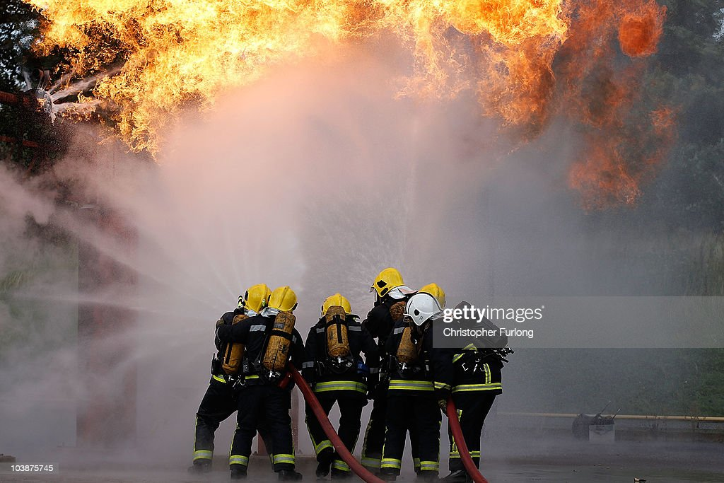 Firefighters from Merseyside Fire Brigade tackle a simulated gas explosion as they take part in the UK's biggest ever rescue exercise on September 7, 2010 in Liverpool, England. The National Urban Search & Rescue Exercise simulated an earthquake and involved brigades across the UK. Part of the simulation included vehicles and people trapped in the Mersey Tunnel.