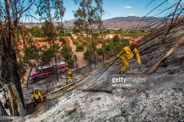 Firefighters from Napa Valley battle to control hotspots of the Maria Fire in Santa Paula Ventura County California on November 02 2019 The Maria...
