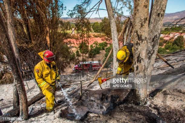 Firefighters from Napa Valley battle to control hotspots of the Maria Fire in Santa Paula Ventura County California on November 02 2019 The Maria...