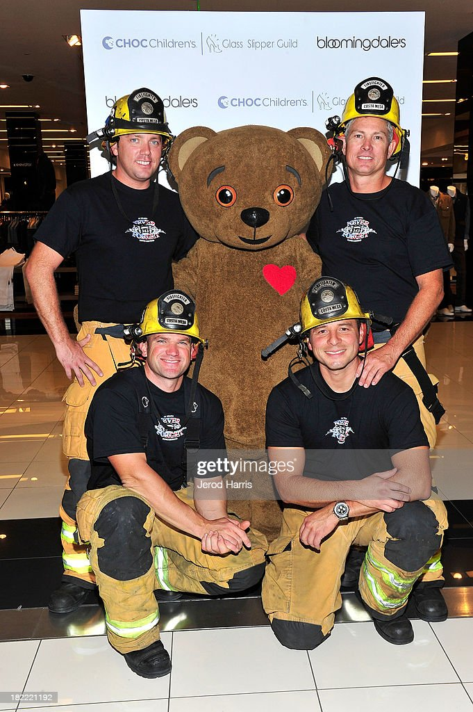Firefighters from the Costa Mesa Fire Department and the CHOC Bear attend the Costa Mesa Firefighter Fashion Show benefitting CHOC Children's Glass Slipper Fund at AnQi Gourmet Bistro & Noodle Bar on September 28, 2013 in Costa Mesa, California.