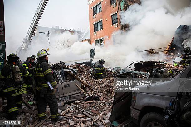 Firefighters from the Fire Department of New York respond to a 5-alarm fire and building collapse at 1646 Park Ave in the Harlem neighborhood of...