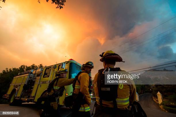 Firefighters from the Governors Office of Emergency Services monitor the advance of smoke and flames from the Thomas Fire December 16 2017 in...