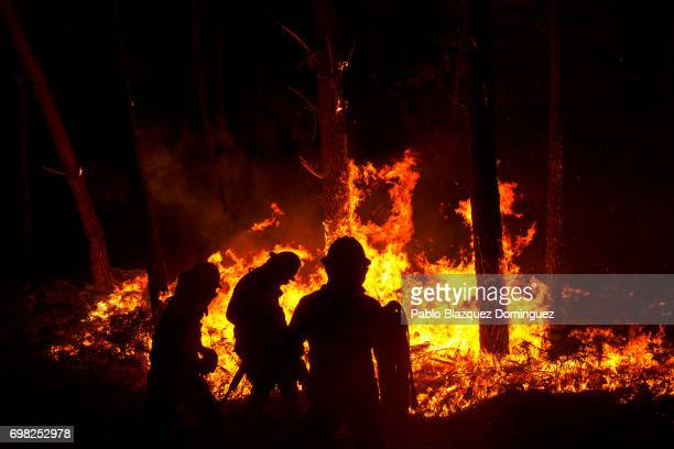 Firefighters from the National Republican Guard GIPS try to control a fire in a forest after a wildfire took dozens of lives on June 19 2017 near...
