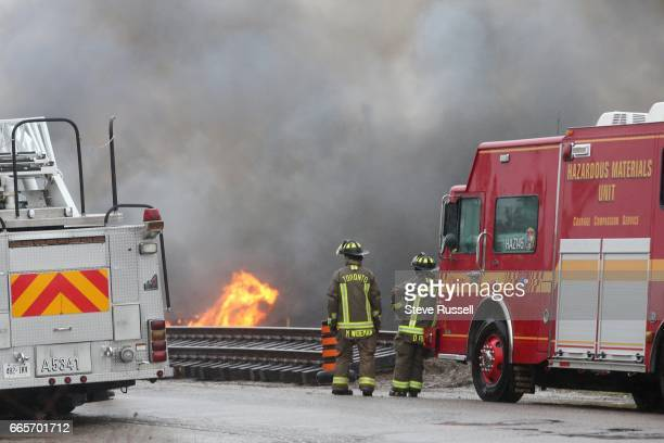 Firefighters from Toronto Markham York WhitchurchStouffville Pickering and more help contain and put out a fire at an auto wrecker building in...