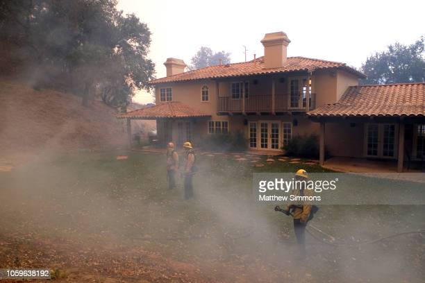 Firefighters from various departments work to protect structures as the Woolsey Fire moves through the property on Cornell Road near Paramount Ranch...