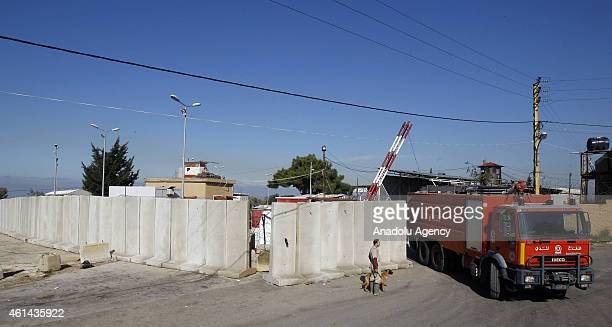 Firefighters go out from the Roumieh Prison where Lebanese security stage an operation against prisoners suspected as the members of Islamic State of...