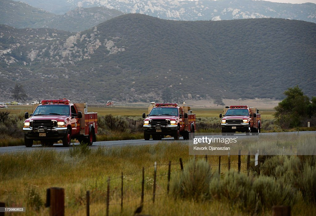 Firefighters head from base camp to fight the Mountain Fire July 18, 2013 near Idyllwild, California. The massive wildfire in Riverside County has grown to 23,000 acres and is advancing toward the mountain town of Idyllwild on one front and city of Palm Springs on the other front destroying several homes and forcing the evacuation of 6,000 people.