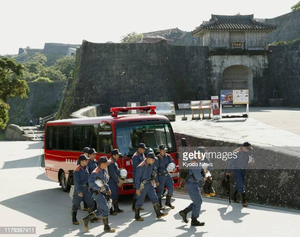 Firefighters head to inspect Shuri Castle in Naha Okinawa Prefecture southern Japan on Nov 2 to find out the cause of a fire that razed the buildings...