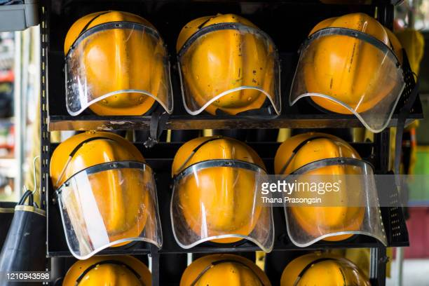firefighter's helmet - lieutenant stock pictures, royalty-free photos & images