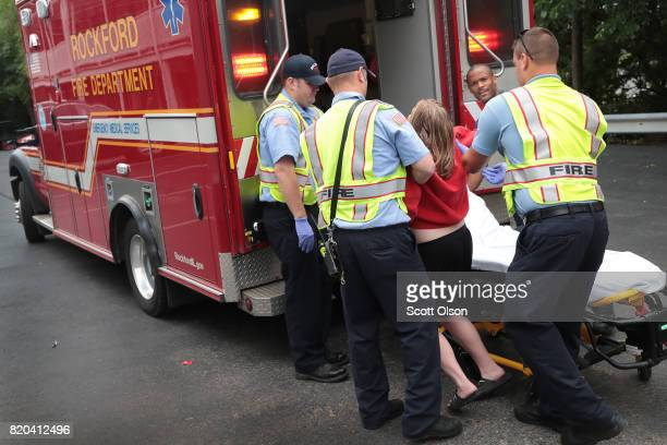 Firefighters help an overdose victim on July 14 2017 in Rockford Illinois The woman was found on the floor of the hotel room where she lived after...