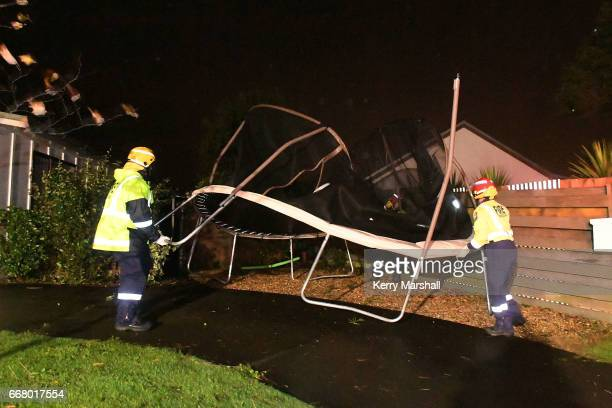 Firefighters help secure a trampoline blown around by high winds from Cyclone Cook on April 13 2017 in Napier New Zealand Heavy rain has hit New...