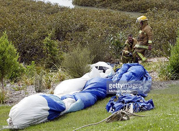 Firefighters help th remove a hot air balloon that made a forced landing in McCleod Park Te Atatu Auckland New Zealand Sunday 31 October 2004