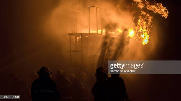 firefighters helped stop the fire . Fire in the Industrial Factory.