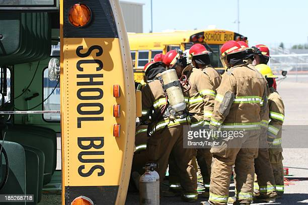 Firefighters helping at a school bus accident