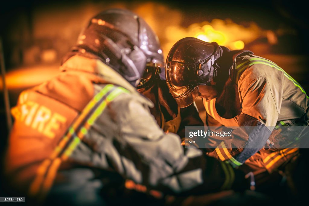 Firefighters helping man : Stock Photo