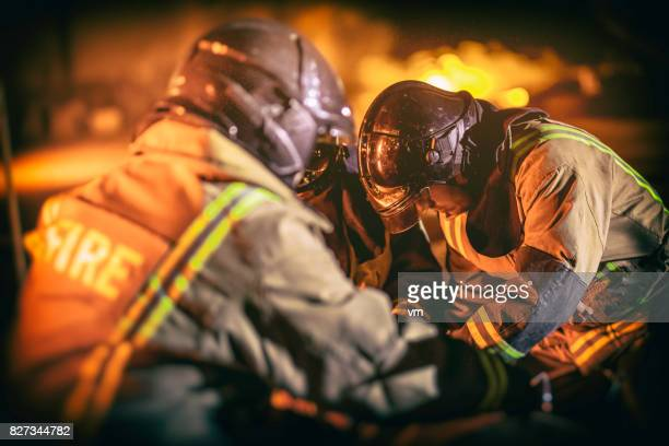 firefighters helping man - rescue worker stock pictures, royalty-free photos & images