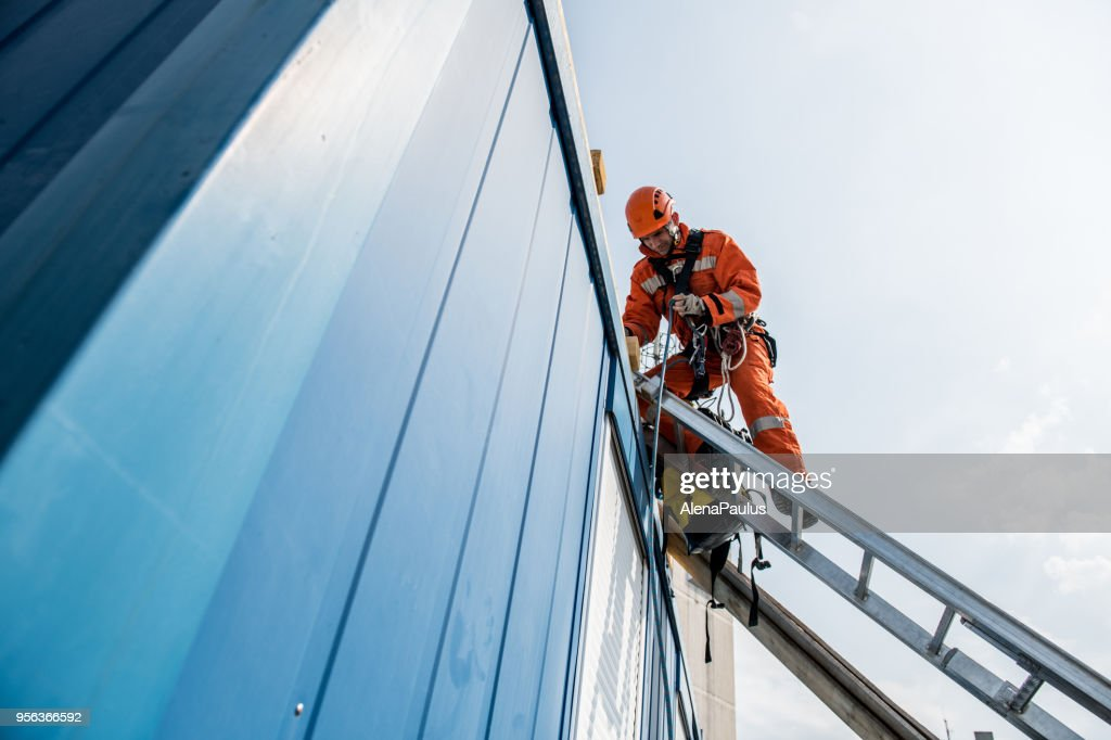 Firefighters in a rescue operation - accident on the roof : Stock Photo