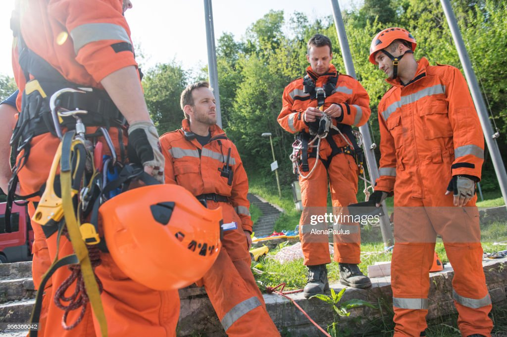 Firefighters in a rescue operation training : Stock Photo