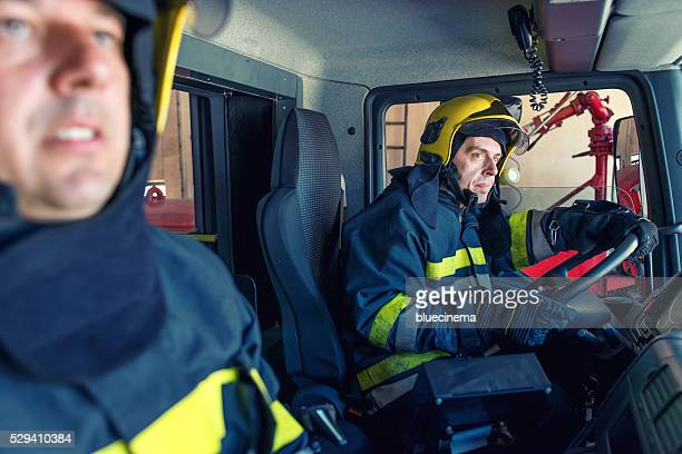 Firefighters in a truck