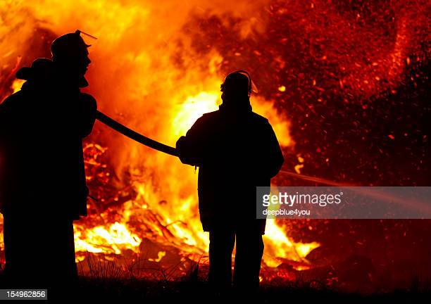 firefighters in action at night