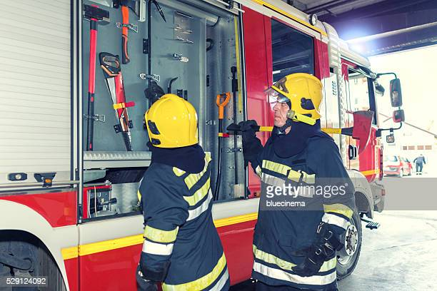 firefighters in action - phosphorescence stock pictures, royalty-free photos & images