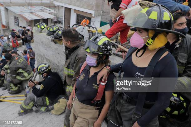 Firefighters in Cerro del Chiquihuite, in Tlalnepantla, State of Mexico, visibly tired after carrying out work to remove debris and search for people...