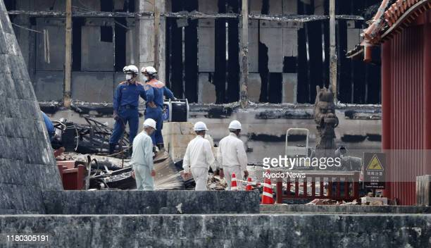 Firefighters in Naha Okinawa inspect on Nov 5 the area where the Seiden main hall stood before Shuri Castle was destroyed in a fire the previous week