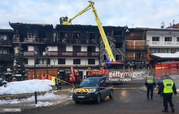 Firefighters inspect a building where two people died and 22 more were injured four seriously in a major fire earlier on January 20 2019 at the ski...