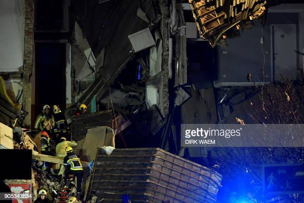 Firefighters inspect a collapsed building at the Paardenmarkt in Antwerp on January 15 after several buildings collapsed following an explosion / AFP...